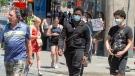 Pedestrians walk on Ste. Catherine Street Thursday, June 18, 2020 in Montreal. (THE CANADIAN PRESS / Ryan Remiorz)