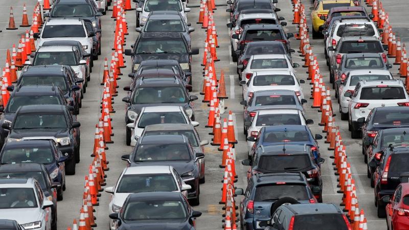 Lines of cars wait at a drive-through coronavirus testing site outside Hard Rock Stadium in Miami Gardens, Fla., on July 5, 2020. (Credit: Wilfredo Lee / AP / CNN)