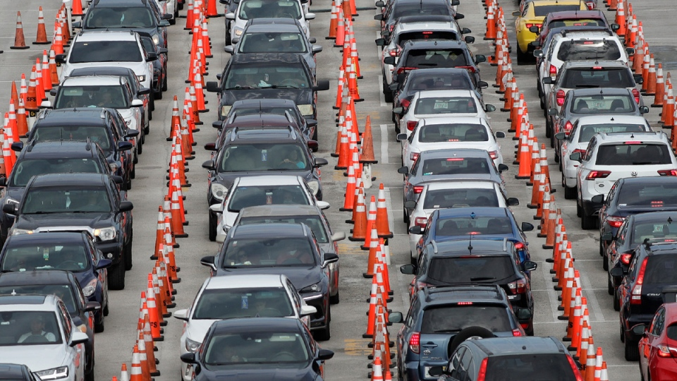 Lines of cars wait at a drive-through coronavirus testing site outside Hard Rock Stadium in Miami Gardens, Fla., on July 5, 2020. (Credit: Wilfredo Lee / AP / CNN)