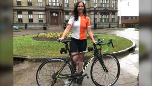 Bianca Hayes poses with her bike in Halifax on July 6, 2020. Hayes left Vancouver on June 16 and pedalled 5,900 kilometres over 20 days to raise money for ovarian cancer research. (Paul Creelman/CTV Atlantic)
