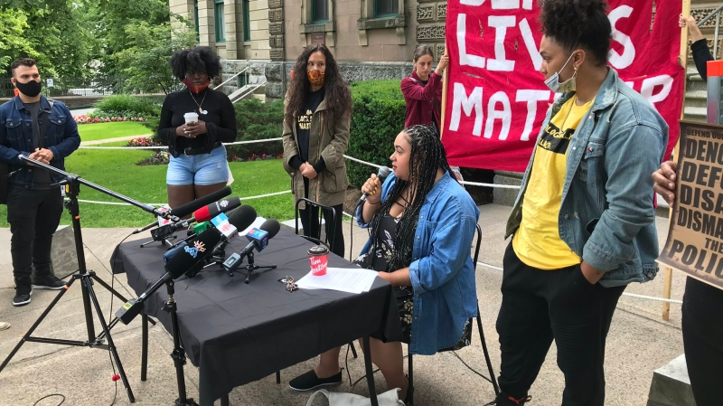 Santina Rao, centre, speaks outside the Halifax provincial courthouse on July 7, 2020. Rao was facing charges of disturbing the peace, resisting arrest and assaulting an officer following an incident at a Halifax-area Walmart in January, but the charges against her have been dropped. (Paul Creelman/CTV Atlantic)