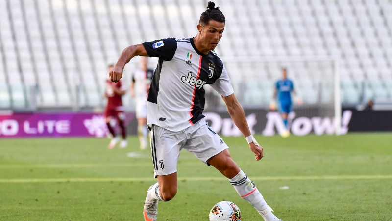 Juventus' Cristiano Ronaldo goes for the ball during the Serie A soccer match between Juventus and Torino, at the Allianz Stadium in Turin, Italy, Saturday, July 4, 2020. Juventus goalkeeper Gianluigi Buffon set an outright Serie A record on Saturday with his 648th appearance in Italy's top flight. The Turin derby game against Torino moved the 42-year-old Buffon one ahead of AC Milan great Paolo Maldini, who set the record in 2009. (Marco Alpozzi/LaPresse via AP)