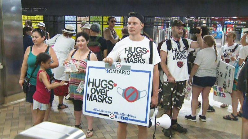 Protesters take the TTC without masks on, calling for an end to Toronto's mandatory policy.