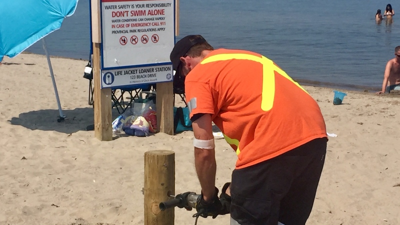 The Town of Wasaga Beach, Ont., is erecting snow fencing to try and block access to the beach after mass crowding. July 7, 2020. (Steve Mansbridge/CTV News)