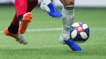 Toronto FC's Terrence Boyd, left, and Vancouver Whitecaps' Scott Sutter vie for the ball during the second half of an MLS soccer game in Vancouver on Friday May 31, 2019. The Vancouver Whitecaps' opening match against FC Dallas at the MLS is Back Tournament has been pushed back. THE CANADIAN PRESS/Darryl Dyck