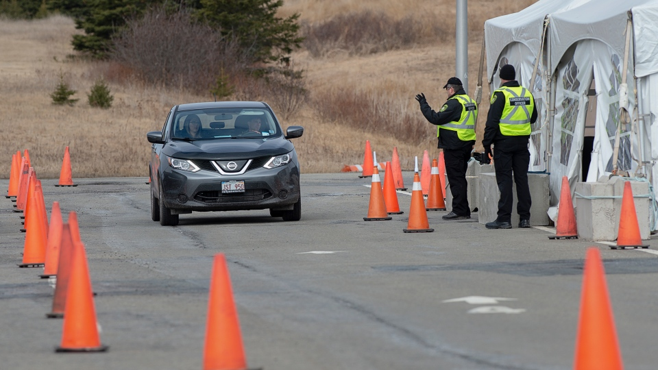 Compliance officers check vehicles at the Nova Scotia-New Brunswick border near Amherst, N.S. on Sunday, April 5, 2020.  (THE CANADIAN PRESS/Andrew Vaughan)