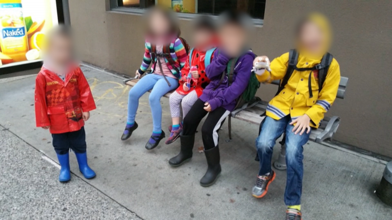 Five children, whose identities are now covered by a publication ban, are shown waiting for a bus in this file photo.