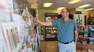Brad Kreutzer, co-owner of Paper Umbrella, looks at cards. The COVID-19 pandemic has taken a toll on his business. (Jeremy Simes/CTV News)