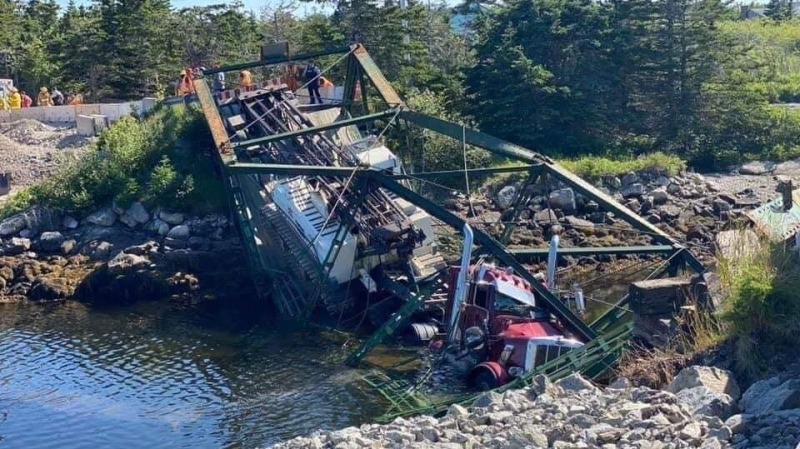 One worker was taken to hospital for observation after Tittle Bridge near Canso, N.S., collapsed while a contractor's truck was driving across it during construction work.  (COURTESY BOB ROBERTS)
