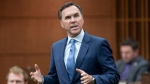 Finance Minister Bill Morneau rises during Question Period in the House of Commons in Ottawa on May 26, 2020. Opposition parties have laid out their demands as the federal Liberal government prepares to update Canadians on the state of the economy after four months of COVID-19.  THE CANADIAN PRESS/Adrian Wyld