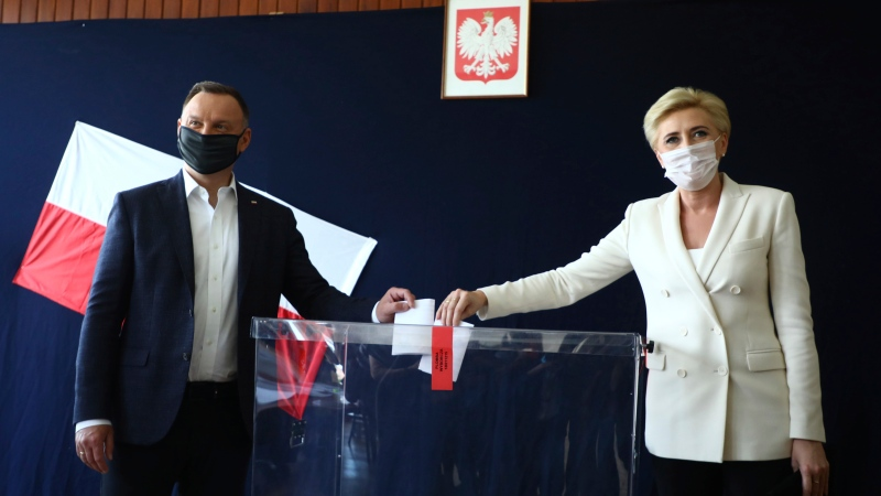 In this June 28, 2020, file photo, Poland's President Andrzej Duda and his wife Agata Kornhauser-Duda cast their vote during presidential election in Krakow, Poland. (AP Photo/Beata Zawrzal, File)