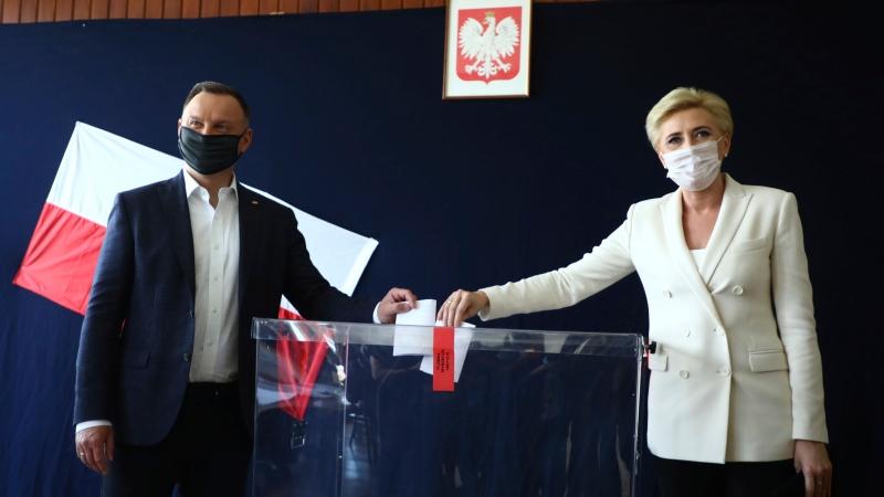 In this June 28, 2020, file photo, Poland's President Andrzej Duda and his wife Agata Kornhauser-Duda cast their vote during presidential election in Krakow, Poland. (AP Photo/Beata Zawrzal, File)