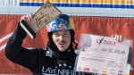 In this Feb. 12, 2017, file photo, winner Alex Pullin from Australia cheers at the snow boarding cross World Cup in Feldberg, Germany. (Patrick Seeger/dpa via AP, File)