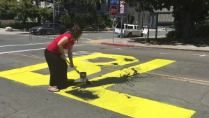 Two people who allegedly painted over a California community's Black Lives Matter mural are each facing a hate crime charge, the Contra Costa County District Attorney's Office said. (Credit: From Youtube / Kerry Leidich / CNN)