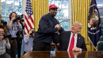 Rapper Kanye West, left, shakes hands with U.S. President Donald Trump during a meeting in the Oval Office of the White House in Washington, D.C., U.S., on Thursday, Oct. 11, 2018. (Bloomberg/Bloomberg/Bloomberg via Getty Images)
