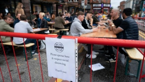 Members of the public are seen at a bar in Manchester's Northern Quarter, England, Saturday July 4, 2020. (Jon Super / AP)