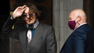 Johnny Depp arrives at the High Court in London, on July 8, 2020. (Alberto Pezzali / AP)