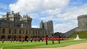 Guardsmen in ceremonies at Windsor Castle last month to mark the Queen's official birthday. The castle, which dates back to the 11th century, is reopening to the public after a long coronavirus shutdown. (AFP)