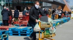 Long lines of masked shoppers wait to shop for groceries in Toronto on Thursday, April 9, 2020. On Tuesday, Toronto and Ottawa joined Kingston in establishing rules requiring a non-medical face covering inside buildings of businesses that are open to the public. THE CANADIAN PRESS/Frank Gunn