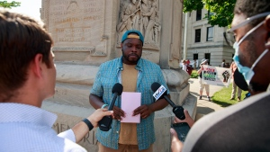Vauhxx Booker speaks in front of the Monroe County Courthouse during a demonstration. (Credit: Jeremy Hogan / SIPA / AP Images / CNN)