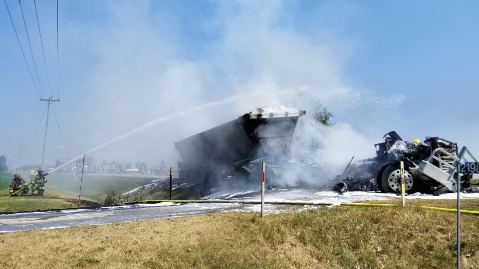 Emergency crews work to put out a fire after a two-vehicle crash north of London, Ont. on Wednesday, July 8, 2020. (Source: @OPP_WR / Twitter)
