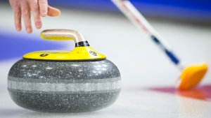 A curler releases a rock during play at the Brier in Brandon, Man., Tuesday, March, 5, 2019. (THE CANADIAN PRESS/Jonathan Hayward)