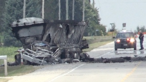 What remains of a transport truck is seen after a fiery two-vehicle crash on Highbury Avenue north of London, Ont. on Wednesday, July 8, 2020. (Jim Knight / CTV News)
