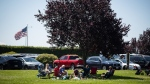 People sit together at Peace Arch Historical State Park in Blaine, Wash., across the Canada-U.S. border from Surrey, B.C., on Sunday, July 5, 2020. THE CANADIAN PRESS/Darryl Dyck