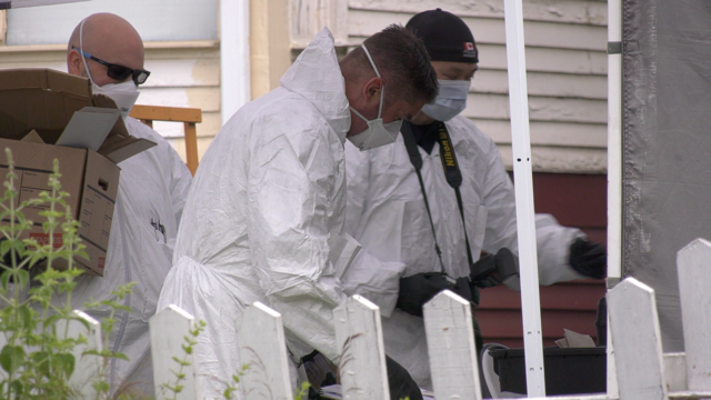 Investigators at a home connected to a double homicide in East Vancouver on July 8, 2020.