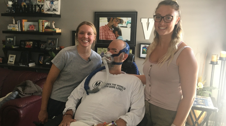 Mario Vella with caregivers Kendall Saravanamuttoo, left, and Renay Singer in London, Ont. on Wednesday, July 8, 2020. (Brent Lale / CTV News)