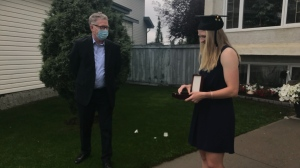 MacEwan University President John McGrath presented Jamie Erickson with the President's Medal at her home on July 8, 2020.