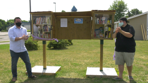 Ottawa Coun. Matthew Luloff and Redeemer Alliance Church Pastor Dylan Armstrong officially open the Orléans Community Little Library and Little Pantry on Wednesday. (Shaun Vardon/CTV News Ottawa)