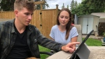 Tye Anderson and his wife Makenna recounting Sunday's water rescue at Waskesiu Lake.