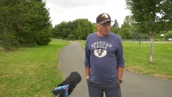 Saanich resident Ted Penston says he is uninjured after he was allegedly assaulted after confronting a man who was hitting his dog.