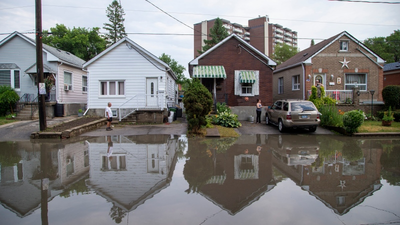 Water fills Cordella Avenue after a severe thunderstorm caused localized flooding in Toronto on Wednesday, July 8, 2020. THE CANADIAN PRESS/Carlos Osorio