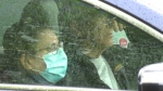 A woman wearing a mask in her car. (file)