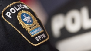 A Police badge is shown during a news conference in Montreal. THE CANADIAN PRESS/Graham Hughes