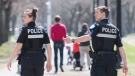 Police officers patrol a city park in Montreal, Sunday, May 3, 2020, as the COVID-19 pandemic continues in Canada and around the world. THE CANADIAN PRESS/Graham Hughes