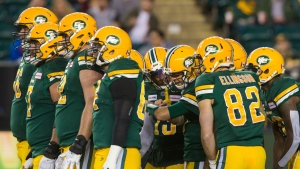 Edmonton Eskimos quarterback Logan Kilgore, centre, talks to teammates in the huddle during his first CFL start, against the Hamilton Tiger-Cats in Edmonton, Alta., on Friday September 20, 2019. THE CANADIAN PRESS/Amber Bracken