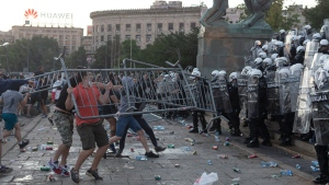 Protesters throw barricades at riot police in Belgrade, Serbia, Wednesday, July 8, 2020. (AP Photo/Marko Drobnjakovic)