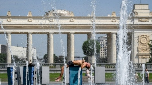 A man cools himself in a fountain in Gorky Park in central Moscow. (AFP)