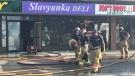 Fire crews at the scene of a fire at Slavyanka Deli on Thursday, July 9, 2020. (Sean Irvine / CTV London)