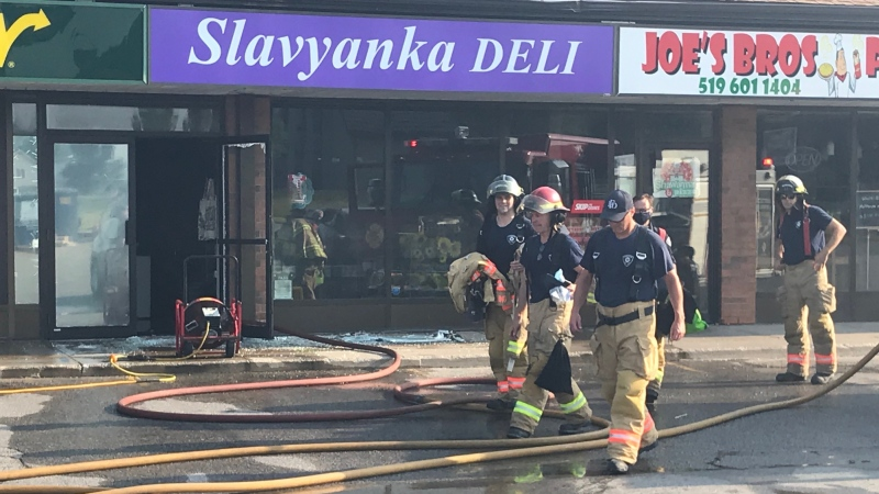 Fire crews at the scene of a fire at Slavyanka Deli on Thursday, July 9, 2020. (Sean Irvine / CTV London)