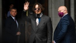 Johnny Depp arrives at the High Court in London, Wednesday July 8, 2020. (AP Photo/Alberto Pezzali)