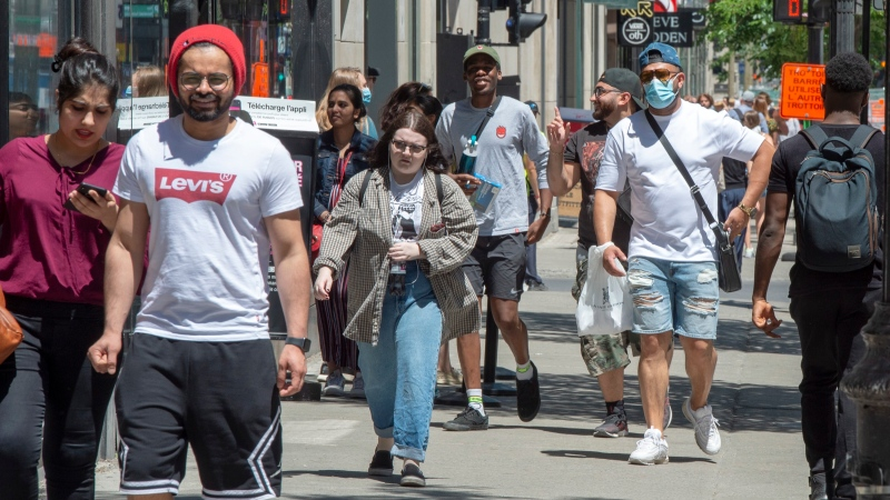 "Pedestrians walk on Ste. Catherine street, Thursday, June 18, 2020 in Montreal. A group of 239 scientists and physicians urging the World Health Organization to recognize the potential for airborne transmission of the novel coronavirus have sparked debate over how COVID-19 is spreading.But some Canadian infectious disease experts say not to get hung up on the term ""airborne."" THE CANADIAN PRESS/Ryan Remiorz"