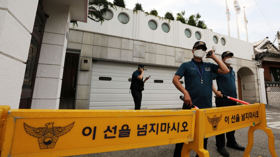 Police officers stand guard in front of the house of Seoul Mayor Park Won-soon in Seoul, South Korea, Thursday, July 9, 2020. The mayor has been reported missing and police are searching for him on Thursday. (Park Ju-sung/Newsis via AP)