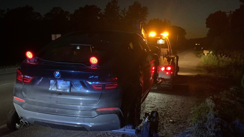 A car being removed by a tow truck after the driver was charged with stunt driving for allegedly going 138 km/h in an 80 zone. (@WRPS_Traffic / Twitter)