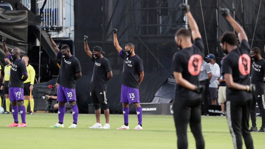 Orlando City players raise their fists