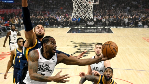 Los Angeles Clippers forward Kawhi Leonard, front left, shoots during the first half of an NBA game, on Dec. 28, 2019. (Mark J. Terrill / AP)