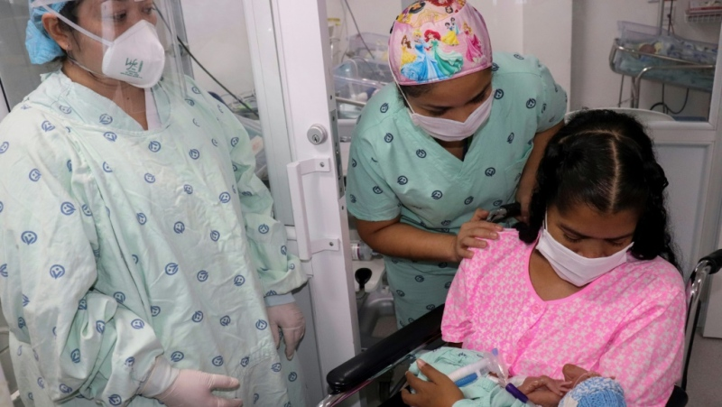 The findings of a new study show the strongest link yet between mother and infant transmission of coronavirus. (AFP)